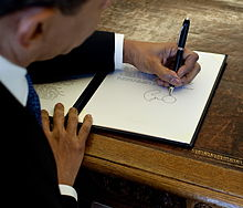 The President Signing Left-Handed